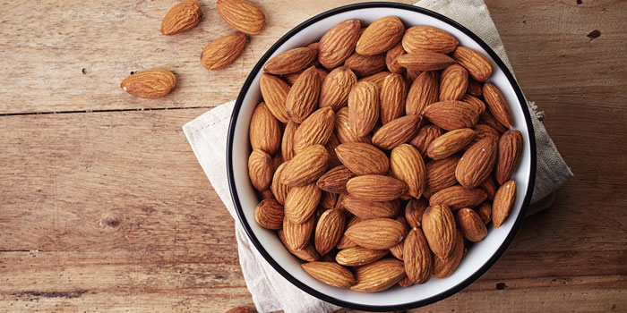 bowl full off almonds on a table